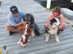 Leo with his doggie friends, Lucy and Eli at the sunset conch horn blowing festivities