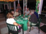 Randy learing to play dominos with new friends at the Marsh Harbour Marina