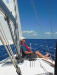 Captain having his afternoon nap during ocean crossing from Exumas back to Eleuthera