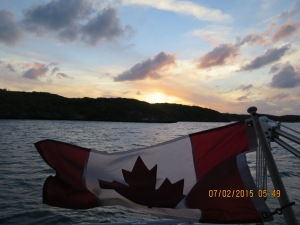 Sunset in Hatchet Bay over Silver Maple's flag