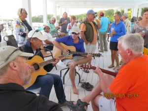 Sunday we have pot luck happy hour by the pool and some of the guys, including Guy (Miss Ellie) play guitar to entertain the group