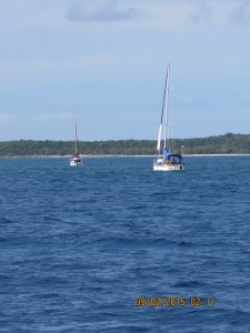 There's a line up of boats entering the cut at South Bar to the Abacos