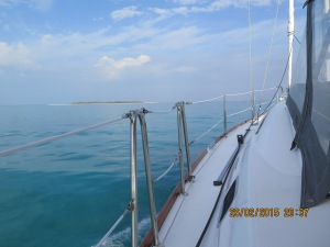 Calm day with distant thunder clouds as we leave to make the Whale Cay ocean passage
