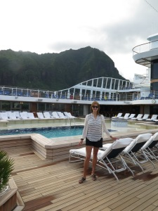Lee by the pool on the ship with the hills of Tahiti behind