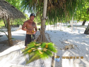 Tour guide serves us fresh fruit on the beach