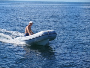 Randy trying the new dingy we bought in Florida.